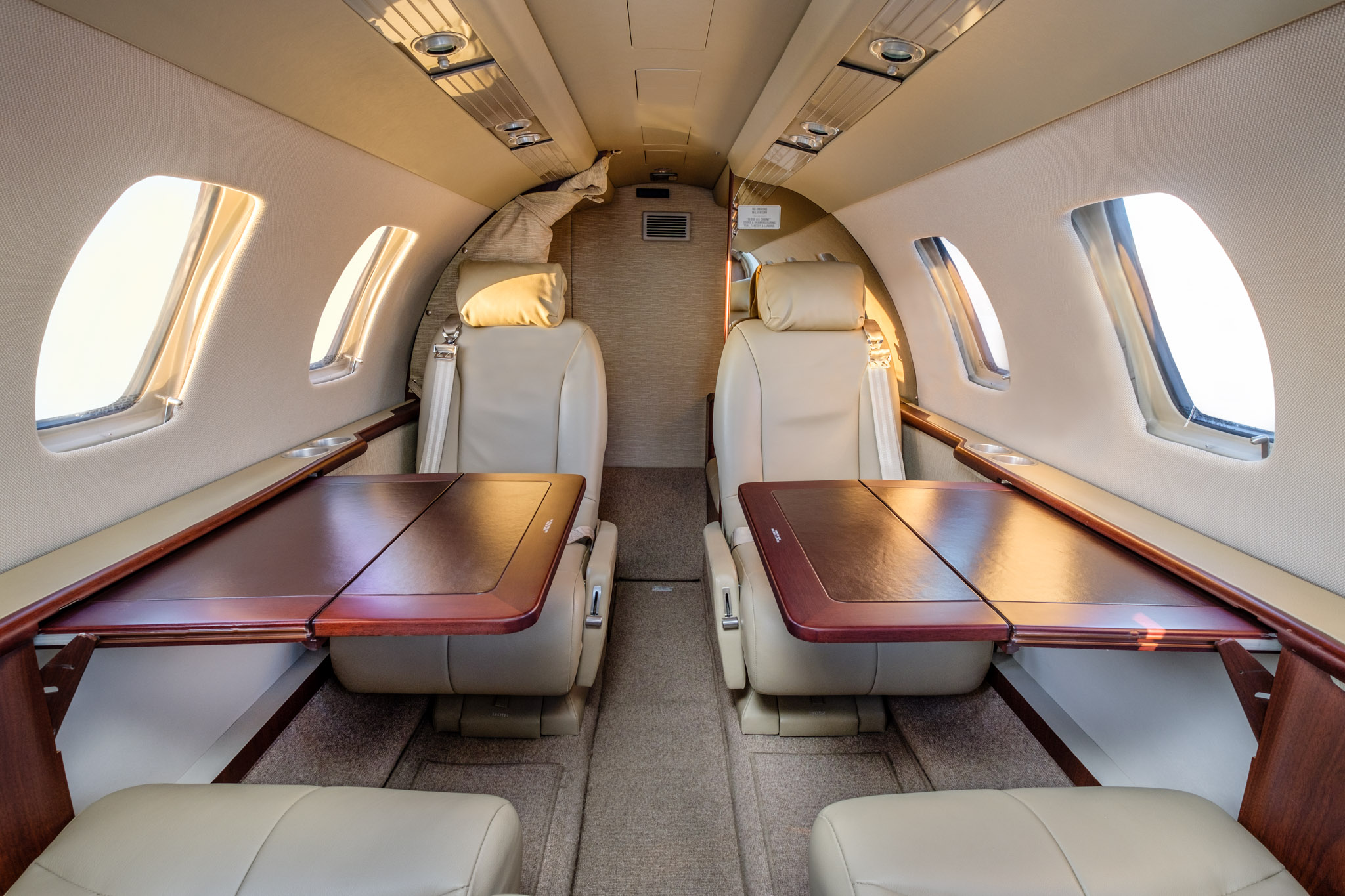 Private charter plane main cabin with pull-out tables