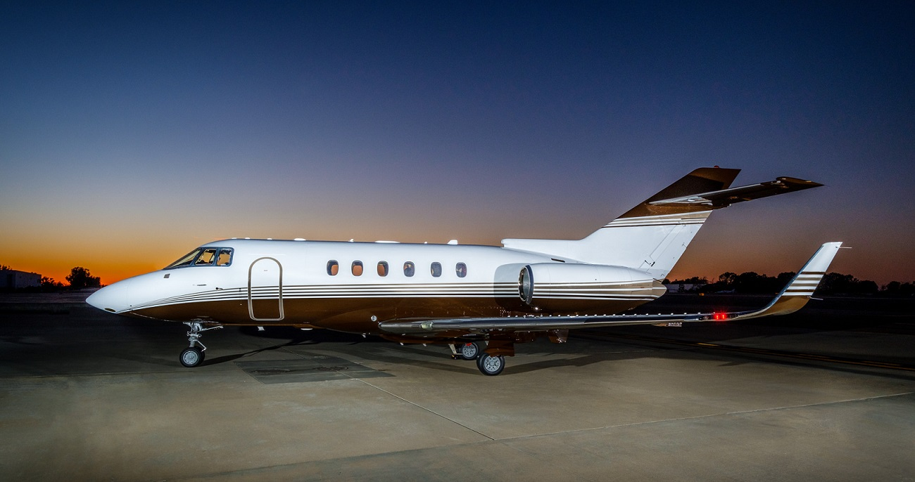 Private charter jet at dusk