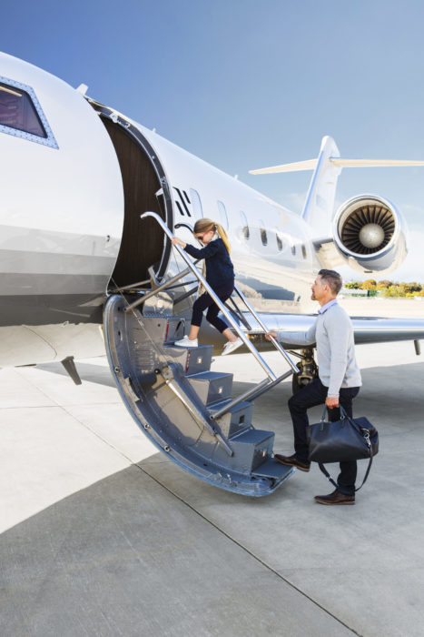 Man boarding Schubach private jet with daughter