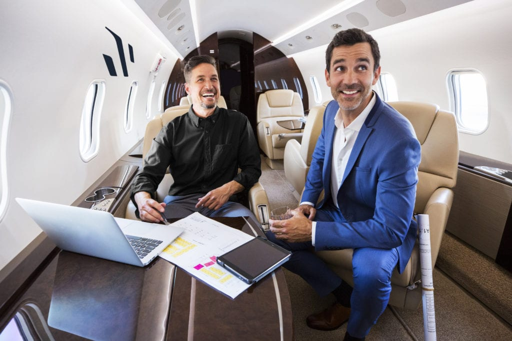 Men working on a Schubach private jet