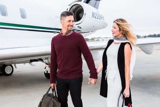 Couple boarding private jet