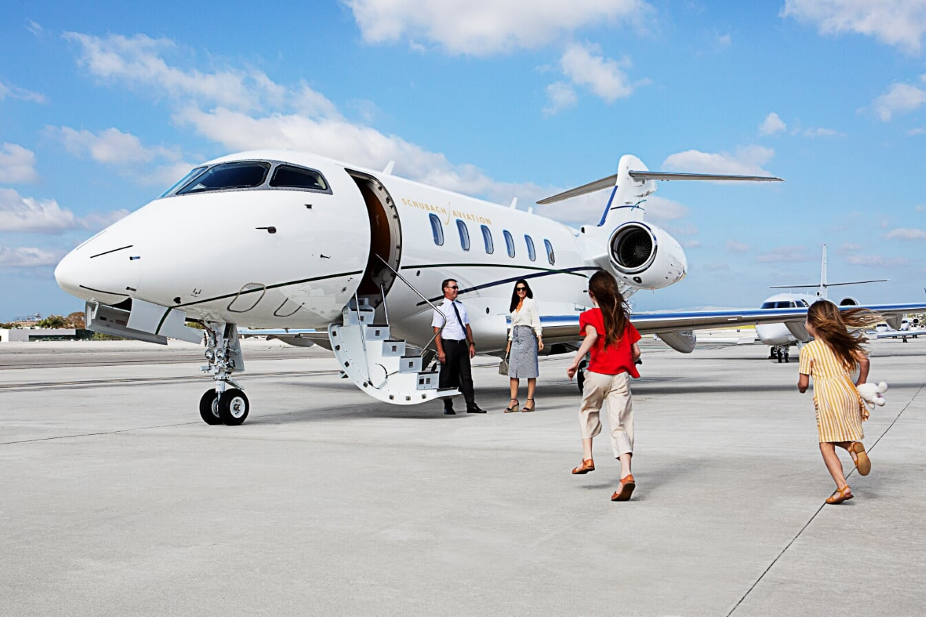 Woman and child getting on a private jet