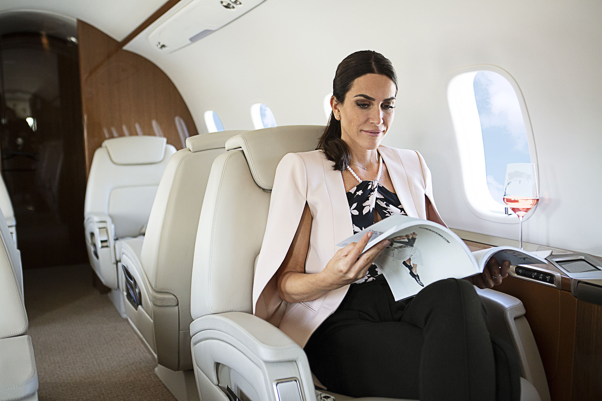 Woman reading on a private jet