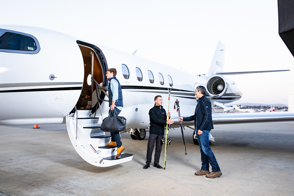 Two men getting on a private jet
